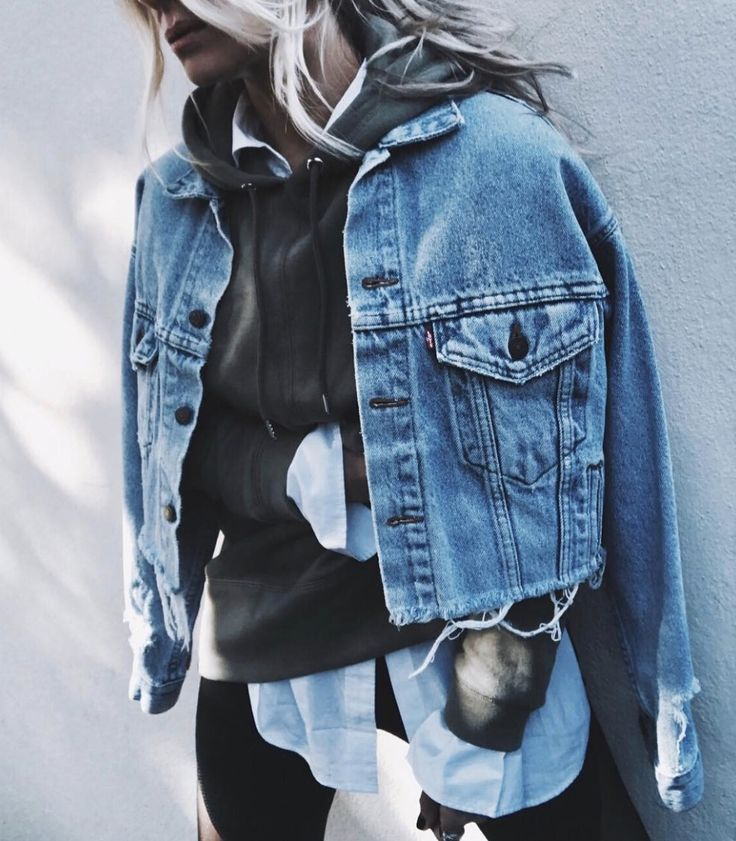 Denim jacket over printed hoody over white button down blouse. How to Layer