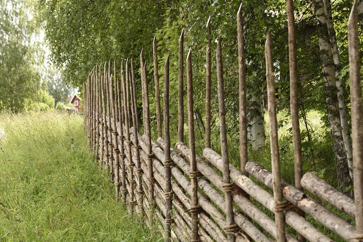 Old handmade wooden fence from the North of Sweden.