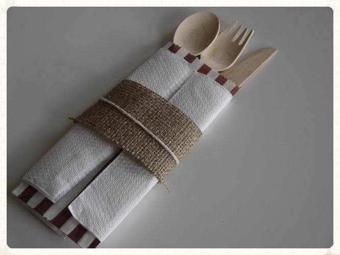 Hessian wrapped cutlery packets, each contains a wooden knife fork and spoon. Great for a rustic wedding reception. Only £5.99 for 10! www.picketfenceweddings.co.uk