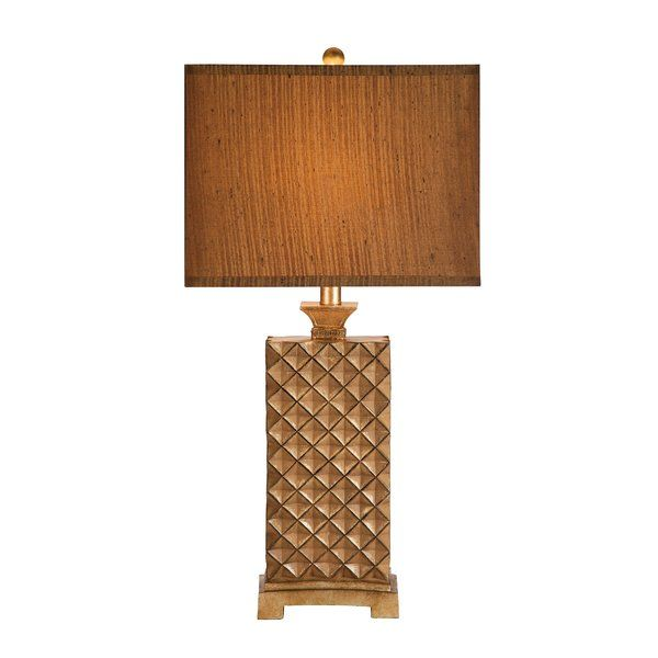 Illuminate your living room, family room, or office with this transitionally styled table lamp. The resin table lamp features a decorative lattice design with a burnished bronze finish and a rectangular silken shade.This lamp is rated for 120-volts and uses a 3-way 150-watt incandescent bulb or 3-way E26 CFL spiral bulb. Bulb not included. The light source is soft and the illumination is pointed downwards. Table lamps are often used in combination to provide ambient lighting. There is a…