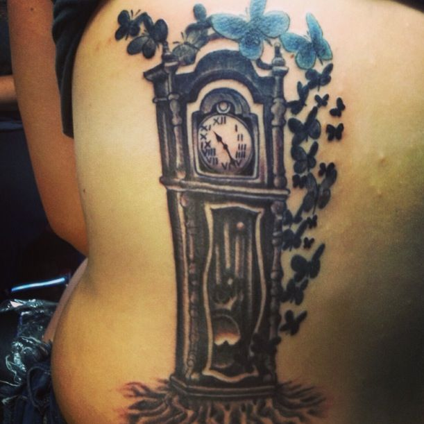 grandfather clock face tattoo. my daughters memorial tattoo for her grandfather the time on clock is his birthday face v