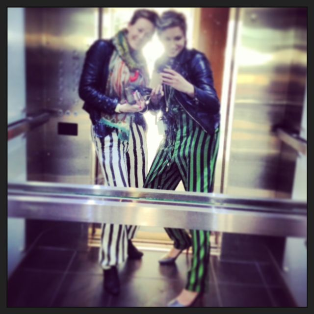 Jumpsuit, green and black stripe, black and white stripe pants.
