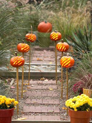 Halloween and Fall Inspired Decorations for your Home: Glowing Gourds (via Parents.com)Fall Pumpkin, Decor Ideas, Garden Pathways, Fall Parties, Autumn Gardens, Gardens Paths, Tiki Torches, Carvings Pumpkin, Gardens Pathways