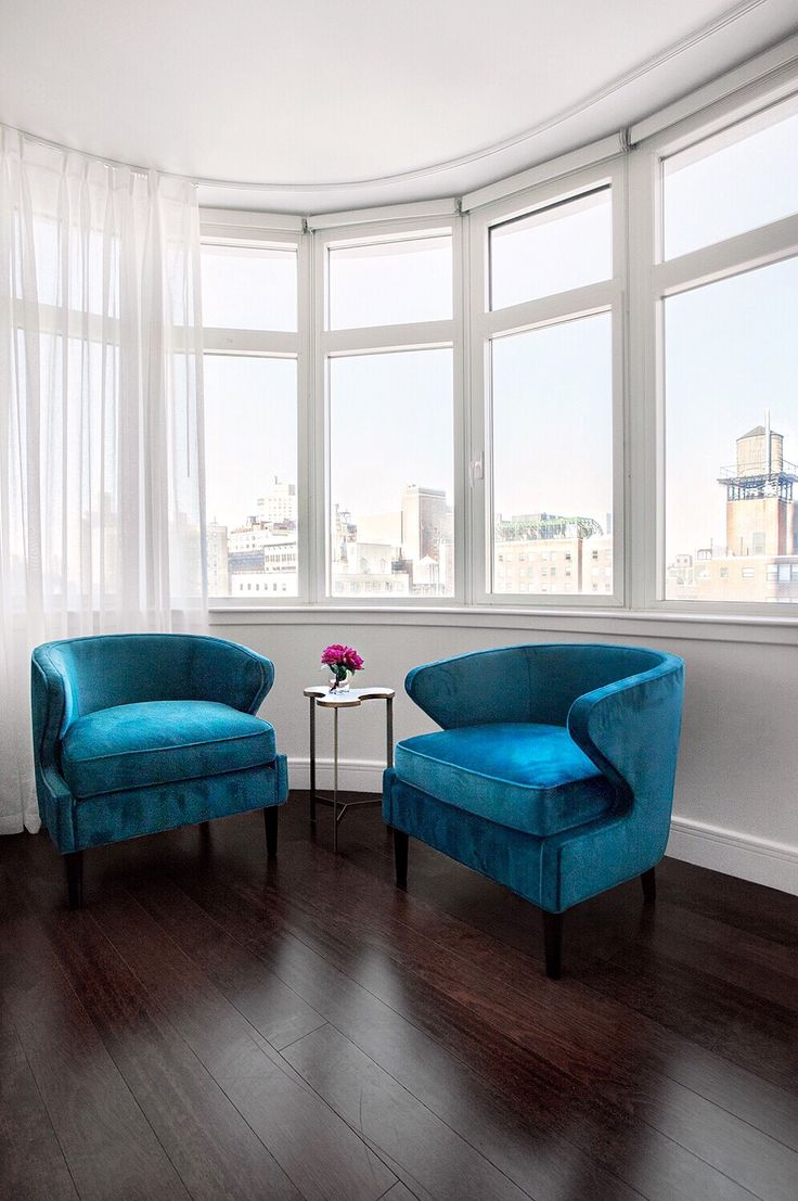 living room in blue%0A Jewelcolored furniture is still very in this fall  Velvet pieces that  incorporate emerald