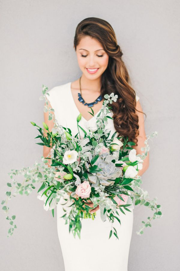 free form wedding bouquet, photo by Angel He Photography http://ruffledblog.com/tampa-modern-wedding-ideas #flowers #weddingbouquet #greenery