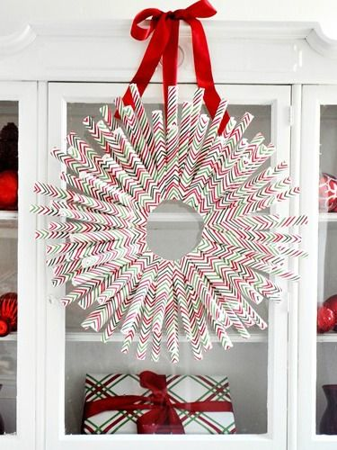 When you're done wrapping gifts, turn the inevitable leftover paper into this clever wreath. #wreathdiy #holidaywreath #holidaywreathdiy