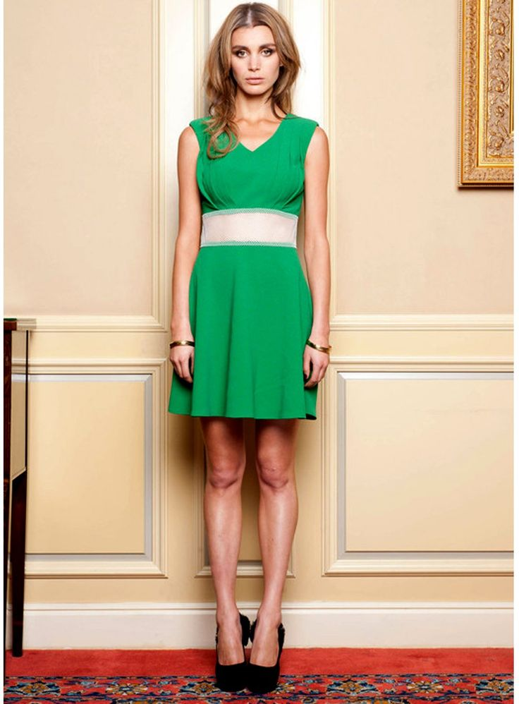 Lovers & Collaborators Sass Net Dress. Emerald green cocktail dress with netting at the waist by Lovers & Collaborators. /   Slightly small fit / Concealed back zip / Polyester Spandex material /