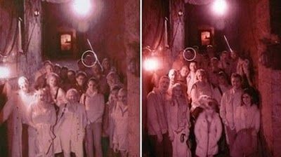 Staff at one of Edinburgh's spookiest tourist attractions have been left mystified after a ghostly figure showed up in the photographs of two separate tourists.
