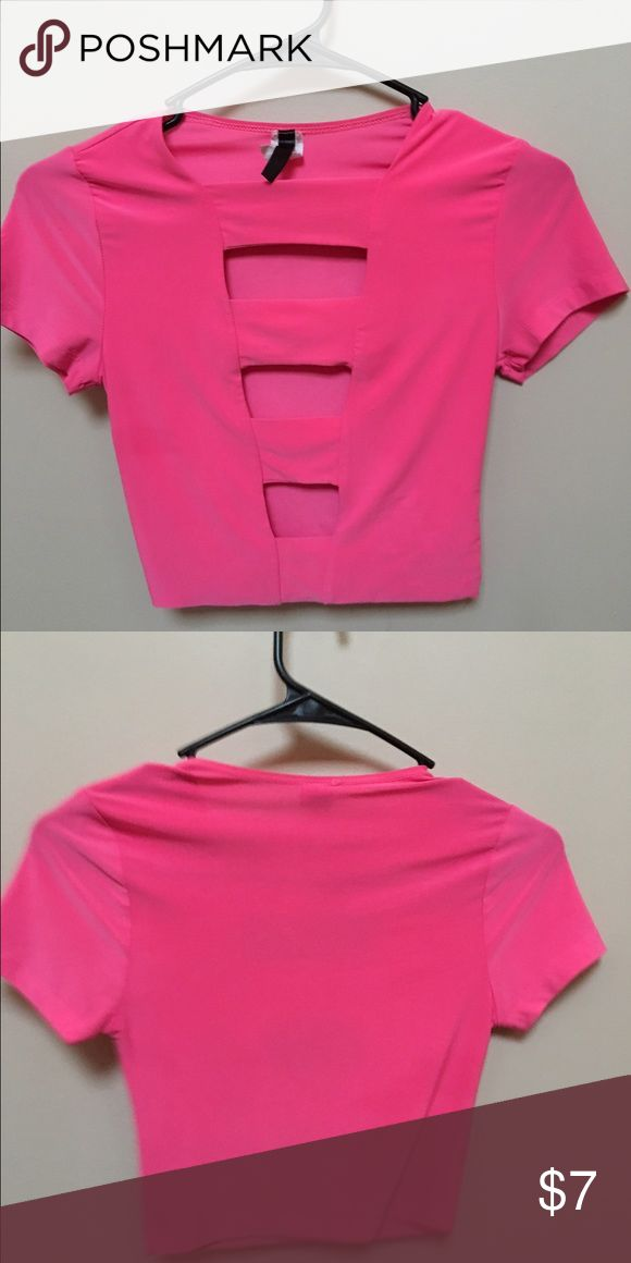 Pink crop top Pink crop top with cutouts in the front. Never found a place to wear it to. Tops Crop Tops