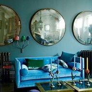 I'm in love with thw colour of this sofa and the huge convex mirrors