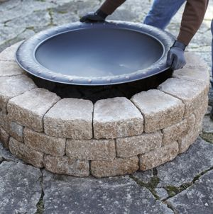 DIY Firepit surround...use flat rocks  The actual firepit from Lowe's $100
