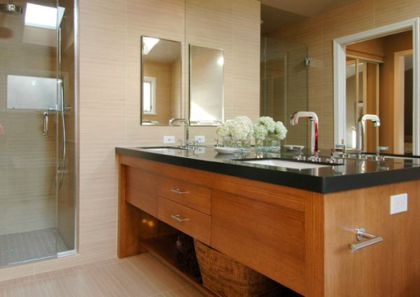 Contemporary bathroom with a large mirror and a chic undermount sink
