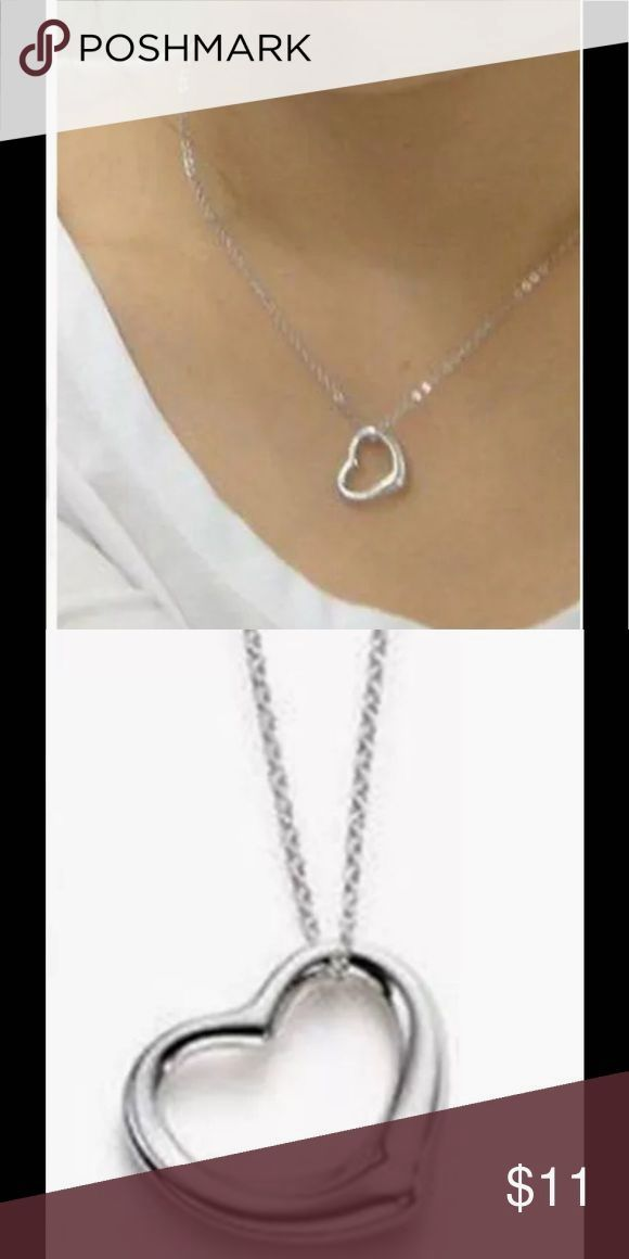 """Silver Floating Heart Pendant Necklace Silver Tone Floating Heart Pendant Necklace. 18"""" Chain and a Lobster Claw Clasp. Jewelry Necklaces"""
