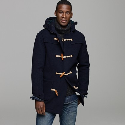 GLOVERALL® MID MONTY DUFFLE COAT. Founded in 1950, London-based Gloverall made duffle coats based on jackets issued to Royal Navy sailors, which were made with hoods big enough for naval caps and fasteners that could be maneuvered with gloves. A reworking of the original Monty duffle coat that debuted during WWII, this one is made in boiled wool and finished with twisted rope toggles. Wool/nylon. Standing collar with hood. Button down neck tab. Patch pockets with tab cuffs. Interior pocket.