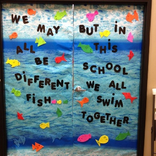 """Fish bulletin board """"we may all be different fish but in this school we all swim together"""" I just cut out different shaped and sized fish"""