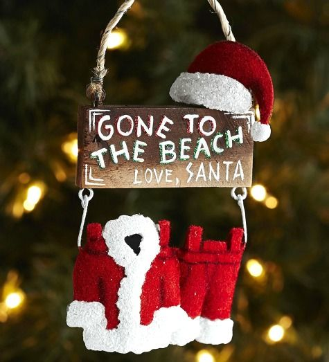 Beach Christmas and Santa Ornaments that are Whimsical and Fun: http://www.completely-coastal.com/2015/11/sea-inspired-coastal-christmas-collections.html