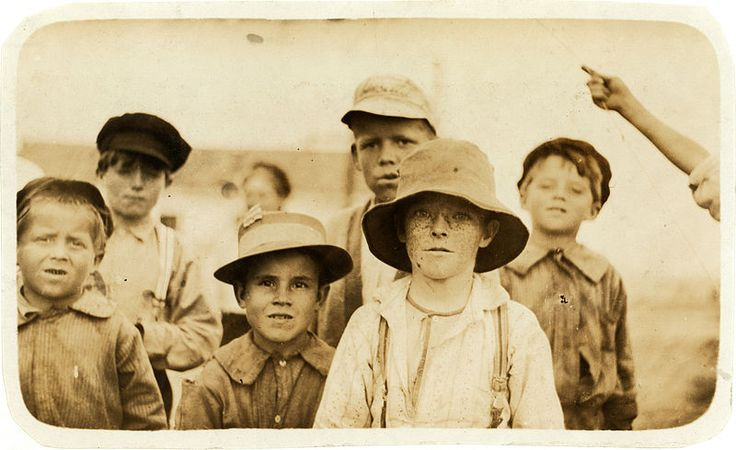 Howard Simmons and Joe Elvis, two of the smallest here, both shuck oysters in Barataria Canning Co. Location: Biloxi, Mississippi. Photograph by Lewis Wickes Hine, February 1911. From the National Child Labor Committee Collection at the Library of Congress
