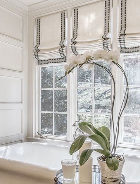 Hang a crisp Roman shade There's nothing sadder than an old, dirty bathroom window. Invest in a tailored window covering that adds sophistication and a little privacy.