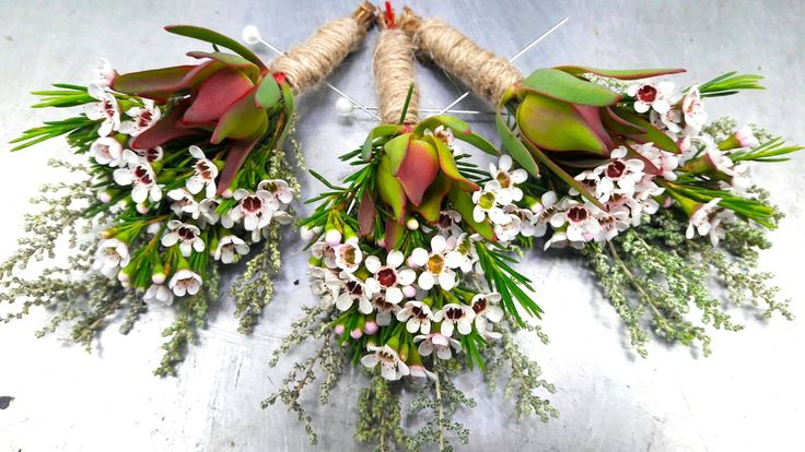 """With boutonnières like these, we aren't entirely sure the groom and his mates won't steal the show!  P.S. Boutonnière is simply the fancy way (read French) to say """"buttonhole""""."""