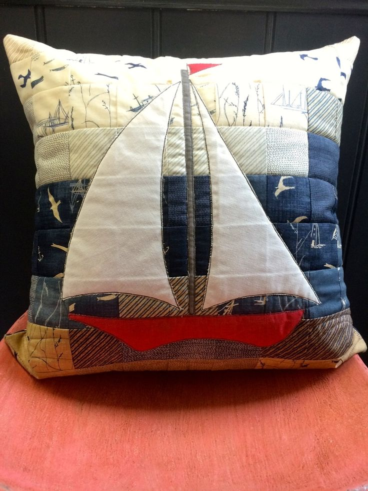 "Using the very popular, and one of our favourite, fabric ranges we've made this sailing boat cushion. It took two 'More Hearty Good Wishes' Moda Candy packs (which are little packs from a range of fabric cut into 2 1/2"" squares), and a few pieces of linen to make the front. We will have a pattern available soon."