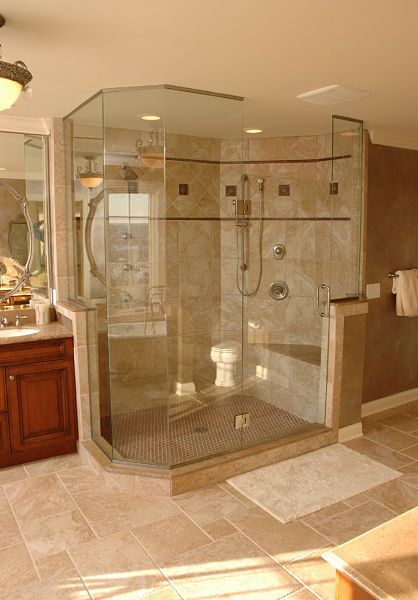 Large walk-in shower with shower seat by Neal's Design Remodel. Can you say HEATED shower seat and floor!