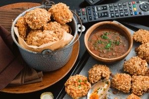 Peanut and pretzel chicken with bloody Mary dipping sauce