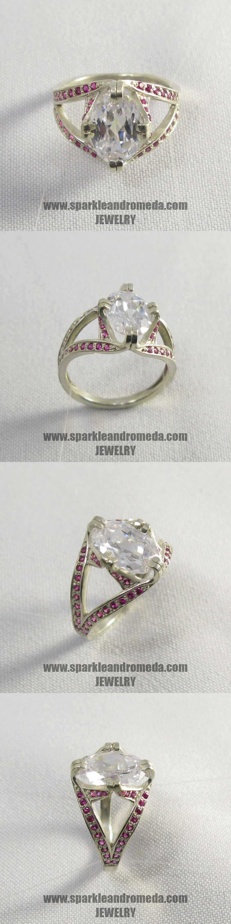 Sterling 925 silver ring with 1 oval 15×8 mm white topaz color and 52 round 1,25 mm pink ruby color cubic zirconia gemstones.