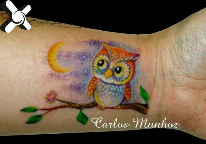 Cute owl wrist tattoo