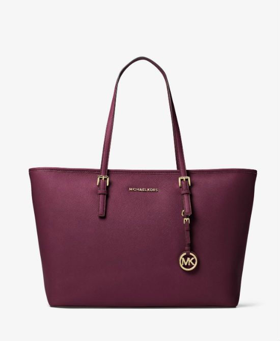 "Chic, functional and a bright pop of color. The Jet Set medium tote from MICHAEL Michael Kors featuring plenty of pockets to keep you organized. - Leather - Medium sized bag; 17"" W x 11-1/2"" H x 5"" D"