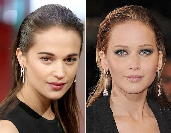 Alicia Vikander and Jennifer Lawrence (© AP/Rex Features)