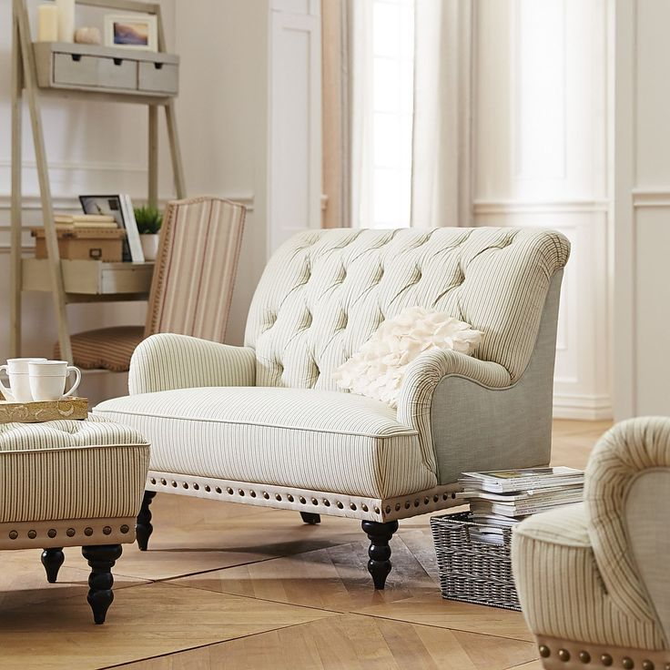 Our overstuffed Chas Chair and a Half is the perfect size—for two to snuggle or for one to extravagantly lounge. With carved hardwood legs, button-tufted upholstery and nailhead trim, it has classic good looks and old-fashioned comfort.