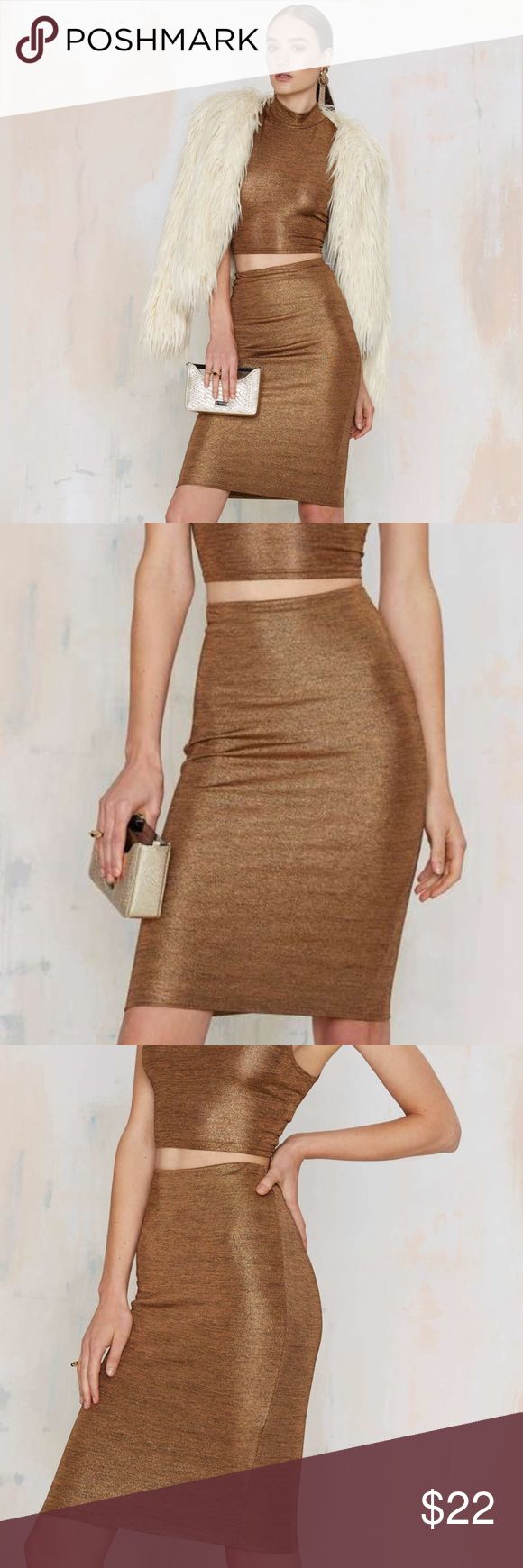 """Metallic Bodycon Midi Skirt New. Ships 1 - 2 days. Add to Bundle to save!   Flash dance metallic pencil skirt. From Nasty Gal By Glamorous. Your moves deserve metallics. The Flash Dance skirt is made in gold metallics and features pencil silhouette and elastic waistband.   95% Polyester. 5% Elasthana. 12.5"""" waist, 23.5"""" length.   Credit to Nasty Gal for model photos. Nasty Gal Skirts Pencil"""