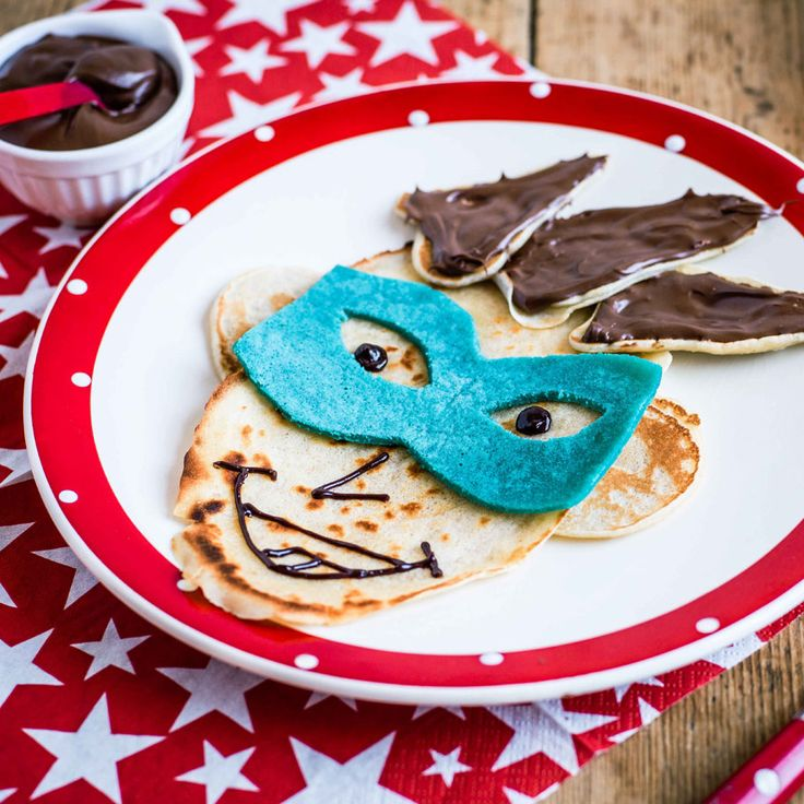 Make Pancake Day all the more fun by turning your pancake into this crafty comic book villain with chocolate spiky hair and a blue mask, all ready for you to gobble up. | Tesco