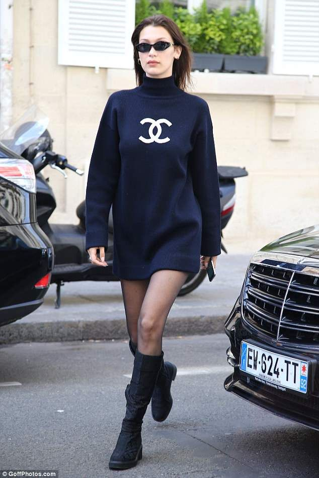 126d17e383437 Back in model mode: The following day Bella was photographed in Paris  putting on a much more stylish display in Chanel sweater dress and sheer  tights with ...