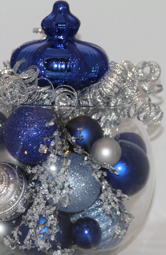 Christmas Centerpiece - Sapphire, Silver and Light Blue Holiday Decoration - Hanukkah Home Decor - Blue Christmas Decorations - Realtor Gift  Want a beautiful and unique centerpiece for your christmas table? We offer unique, handmade christmas decor to compliment your personal christmas scheme. Looks great from all angles.  One of my most popular creations, this centerpiece is a gorgeous combination of pale blue, silver, and sapphire ornaments topped with a beautiful assorted of silver…
