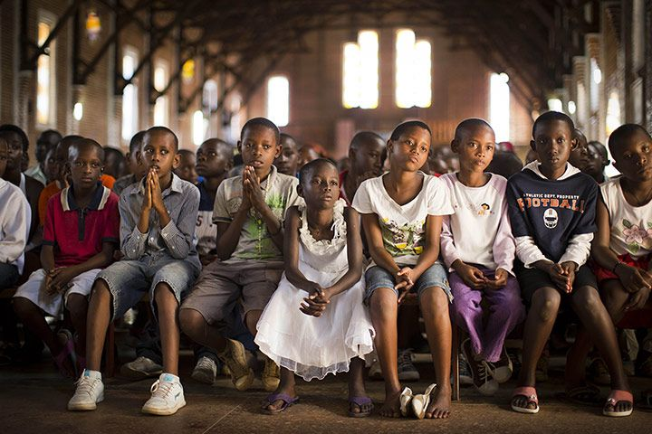 Credit: Ben Curtis/AP Some of the best photojournalism this week came from Rwanda as the 20-year anniversary of the genocide was commemorated. Here, in Kigali, children are photographed by Ben Curtis at the Saint-Famille Catholic church, the site of many killings in 1994