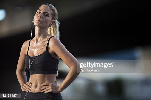 Stock Photo : Woman resting after exercising on city street