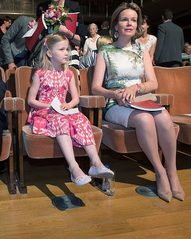 Princess Eleonore (7) and her mother Queen Mathilde of Belgium listen to the semi finals session of the Queen Elisabeth Piano Competition 2016 at the Brussels' Flagey on May 9, 2016 in Brussels.