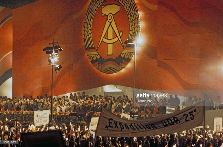 GDR celebrating its 25th anniversary, demonstration of young members of the Free German Youth FDJ organisation Unter den Linden in East Berlin