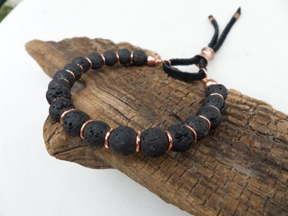 The way the lava stone and copper compliment each other gives this bracelet its beautiful, zen appearance. This bracelet looks great worn alone or stacked with other bracelets.  This bracelet has been handmade from 8mm black lava stone beads and copper rings, that have been strung on strong, multi-strand, flexible wire for comfort, longevity and durability.  The black suede and hand forged copper sliding clasp is a unique feature that helps make this bracelet unique. The copper will…