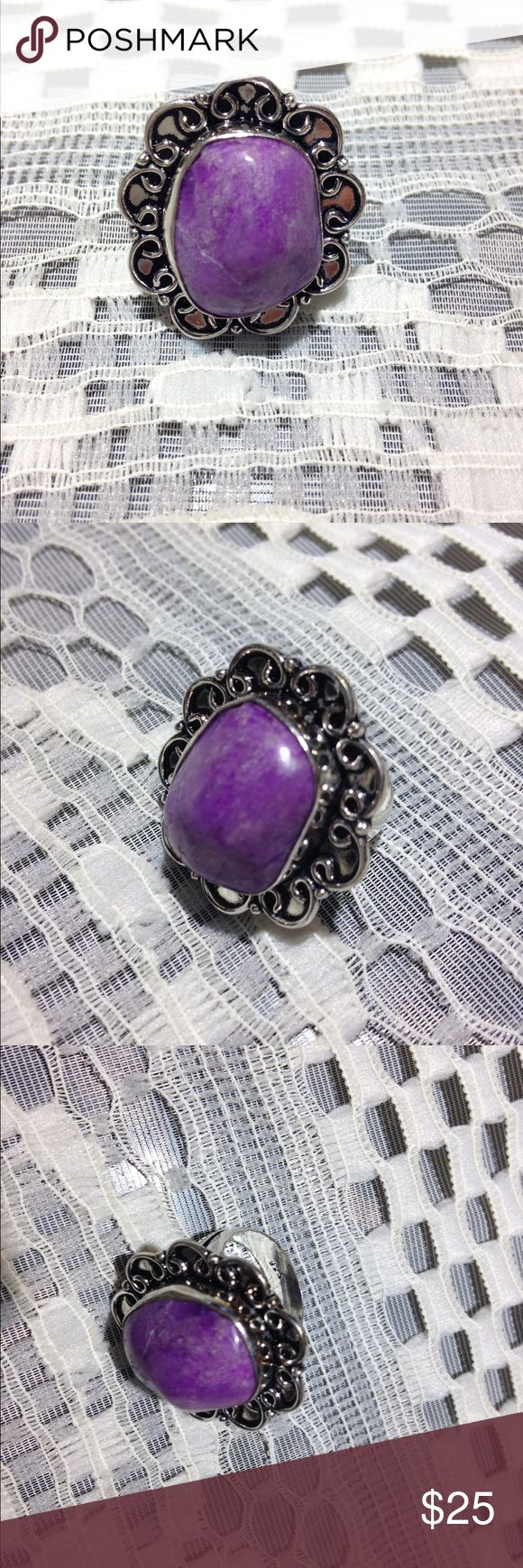 NIB Sterling Silver Semi-Precious Stone Ring Beautiful ornate sterling silver 925 stamped ring with genuine semi-Precious purple stone (I believe it is Charoite, but it is not labelled) Brand new in original packaging. Measures 1 7/10 cm in diameter. Jewelry Rings