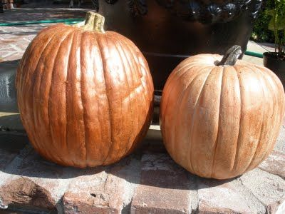 Love the look of real pumpkins, but don't want them rotting in your house? Make artificial pumpkins look like the real thing- awesome. :)