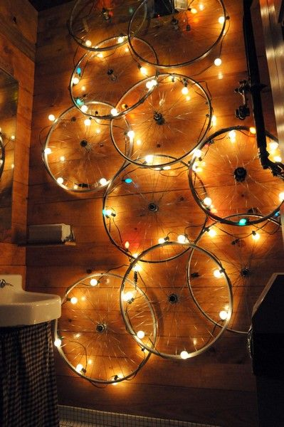 Bicycle Rims with Lights!Would look gorgeous with multi-colored mini lights as a wall display for Christmas!