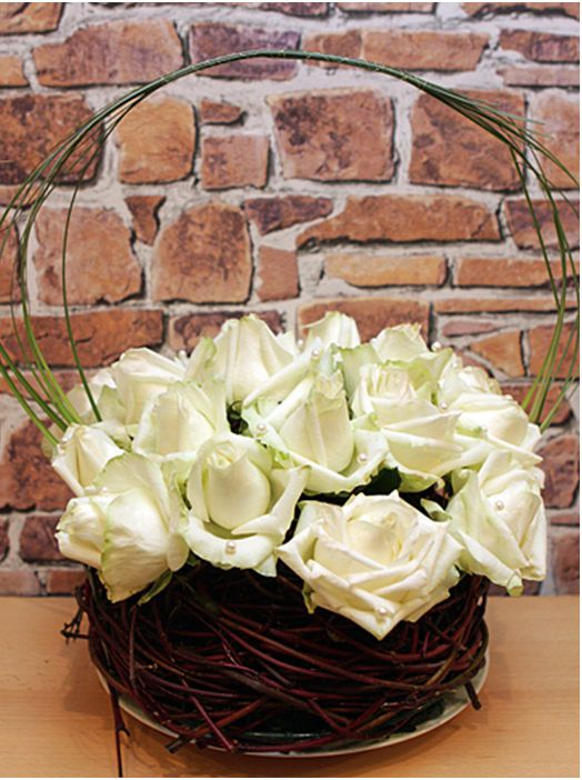 What types of flower arrangements do I need to purchase for my wedding day?  (Shown - http://www.diy-enthusiasts.com/diy-home/diy-flower-arrangement-ideas-roses/)