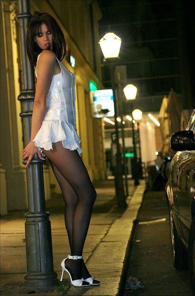 Kate crossdresser transvestite skirt tights heels smoking out and about in public walking