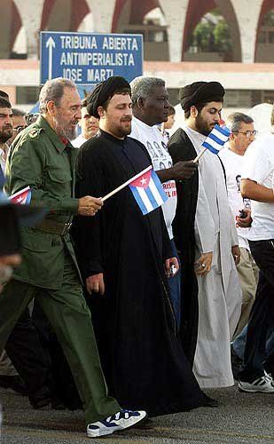 Fidel Castro marches alongside Hassan Khomeini, grandson of the late Ayatollah Ruhollah Khomeini, in Havana to celebrate the start of the Cuban revolution nearly 50 years ago.