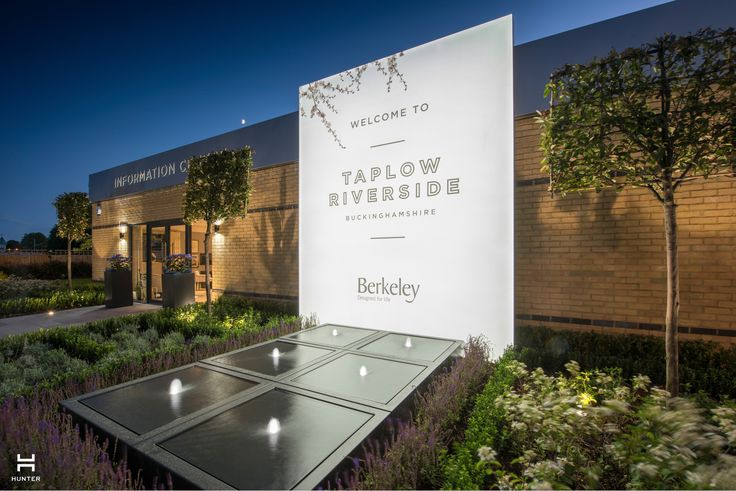 Taplow Riverside Marketing Suite www.hunter-design.co.uk  Large illuminated signage with refelection pool and contemporary landscaping.