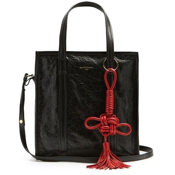 Balenciaga Bazar small grained-leather tote (1,970 CAD) ❤ liked on Polyvore featuring bags, handbags, tote bags, black, balenciaga tote, tote bag purse, tassel handbags, stripe tote bag and handbags totes