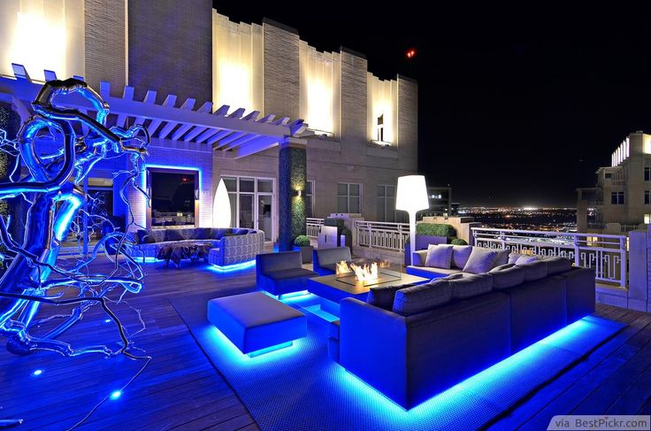 1) Contemporary Deck Patio Lighting Ideas.  2) Lighting The Deck With Fascinating Stars On The Floor.  3) Modern Deck With LED Stair Lights.  4) Subtle Lighting Patio Design Ideas For Deck Rails.  5) Eclectic  Deck With White Accent Tree.  6) Transitional Deck With Sleek Fire Pit.  7) Decorative Glasses With LED Lights Deck Patio Ideas.  8) Low-Level Luxury Deck Lighting Idea.  9) Organic Rooftop Patio Garden Design Idea.  10) Cozy Deck With Perfect Outdoor Ligting.