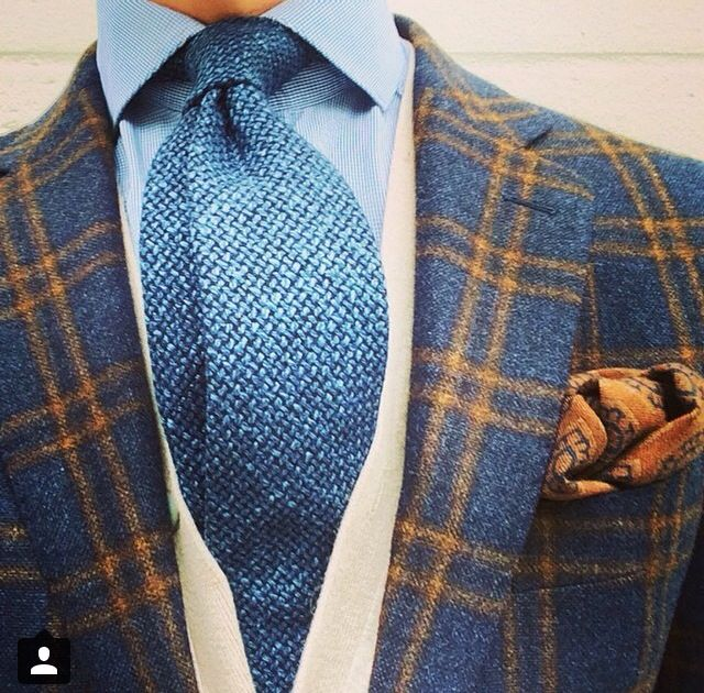 Plaid, solids, paisley, wool, knit, cotton, blue, orange, beige. Nicely layered.